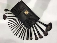 תיק שחור דמוי עור מכיל סט של  22 מברשות משיער טבעי